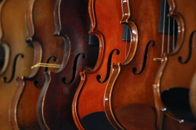Restored violins are displayed in Mathias Menanteau's workshop in downtown Rome December 7, 2012. Born in France, Menanteau has resided in Britain, Berlin, New York and Paris while honing his skills in making and restoring musical instruments. Besides following the traditional techniques and methods used by eighteenth-century Italian violin makers to create his own bow instruments, Menanteau also adopts the less rigid, scientific approach of dendrochronology - the science of dating events and changes by observing annual growth rings in timber - when restoring these instruments in his workshop. Picture taken December 7, 2012. REUTERS/ Alessandro Bianchi (ITALY - Tags: SOCIETY ENTERTAINMENT)